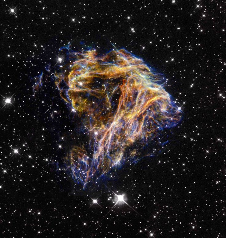 Filaments of gas and dust surround a neutron star, all that's left after a supernova explosion. Decades before this observation was taken, this neutron star gave off a tremendous gamma ray burst measured by numerous satellites.
