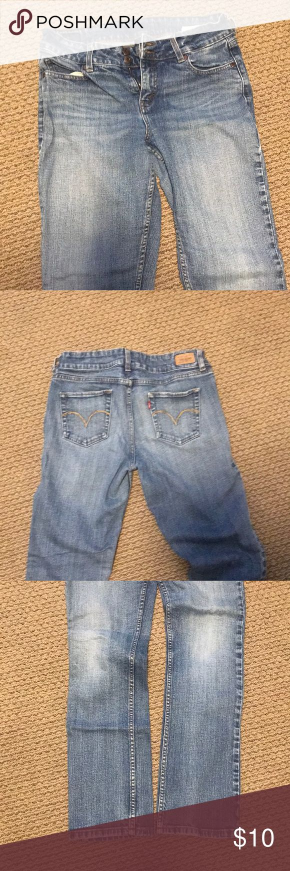 Levi's Slender Straight 526 jeans Great jeans with straight legs and a little stretch. One belt loop torn, as shown in picture. Double button fly. A lot of wear left in these jeans! Price reflects condition Levi's Jeans Straight Leg