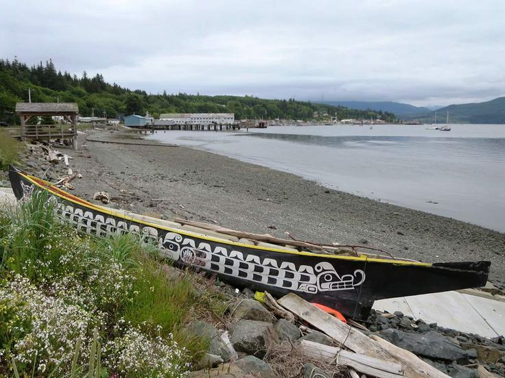 A 'Namgis dugout canoe pulled up on a beach at Alert Bay, British Columbia, Canada.