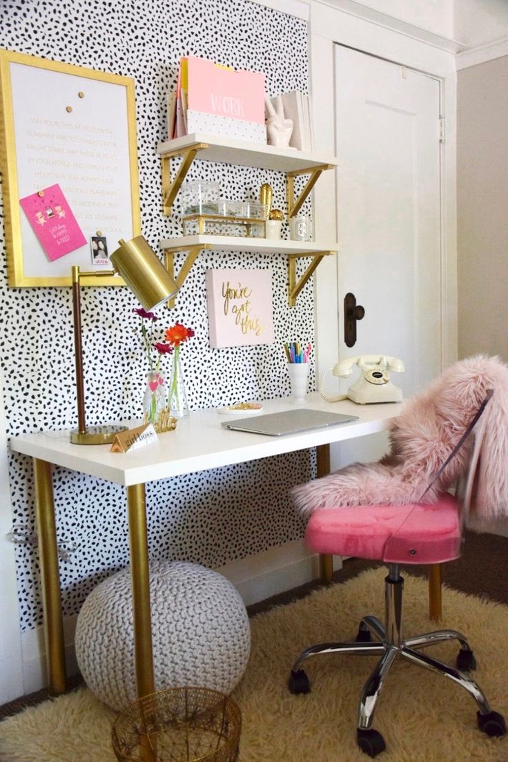 Make fashion and fun work for you. A studio desk. Floating shelves. Touches of metallic and bold color. See this small office makeover on the blog.