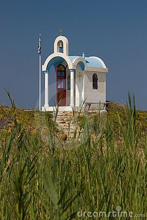 White little chapel with Greek flag in Greece, Sarti.