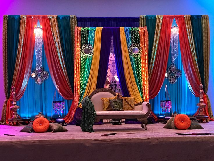 Mehandi Sangeet Moroccan pakistani Indian colorful jewel tone colors decor with chandelier backdrop