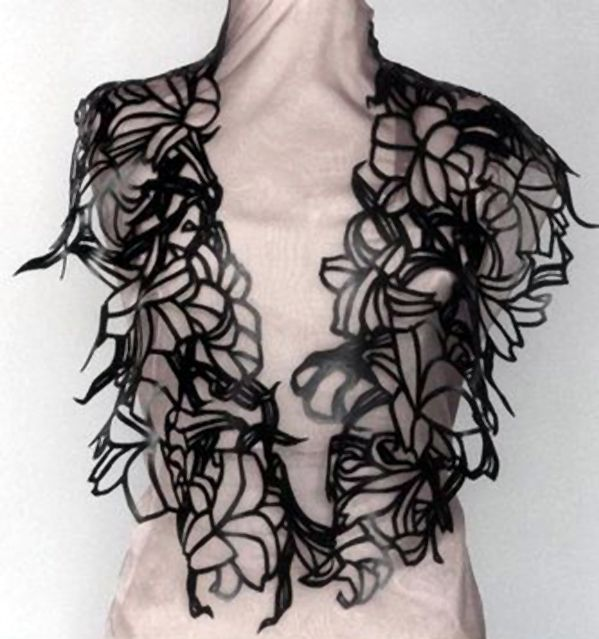 Neckpiece | Thea Tolsma. Made from recycling rubber inner tubes.  1994