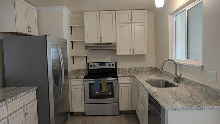 Caspian cabinets from Lowe's Sherwin Williams steamed milk paint color Glacier sands marble countertops Whirlpool appliances #caspian #lowes #sherwinwilliams #steamedmilk #whirlpool