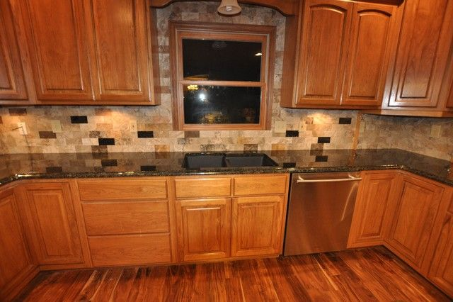 tiled kitchen countertops designs- oak with dark tile countertops... love the backsplash too.