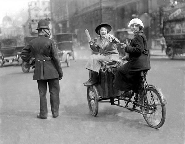 Two women on a delivery bike, 1927.
