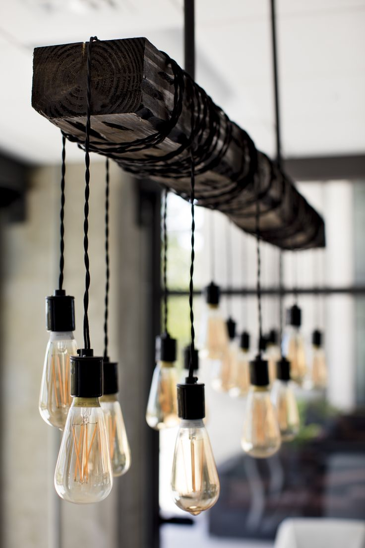 Edison bulb chandelier in this new conference room