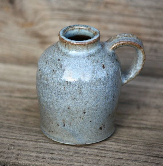 Beautiful blue small jug vase, wheel thrown pottery. This would be cool to drink hot tea or cider out of.