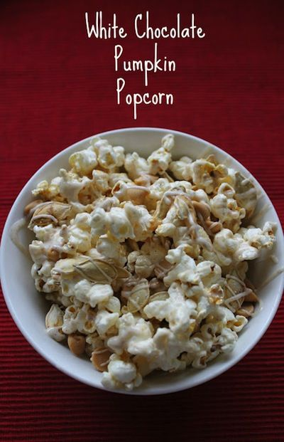White Chocolate Pumpkin Popcorn  Used my own seeds made the day before.  The butter and spice combo would be nice even without other stuff.  couldn't get my chips to melt right to drizzle in the microwave.  If I did this again would melt on stove.  Good and unique even with the difficulties.  cut the spices a bit.