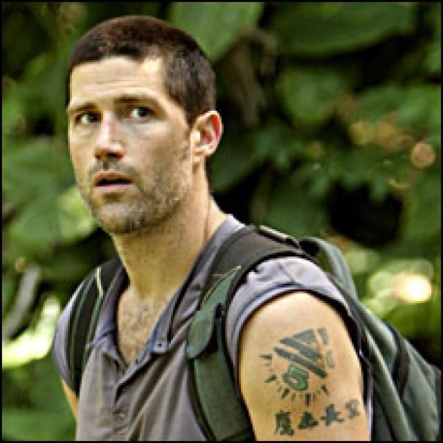 "3 The tattoo on Jack's left shoulder has the number ""5"" with four Chinese characters underneath it. It translates as ""Hawk in the expansive sky"" or ""Eagles high, cleaving sky,"" but according to one of the characters, the island's native inhabitant named Isabel, the tattoo literally means ""He walks amongst us but he is not one of us."" In the episode ""Stranger in a Strange Land,"" it is revealed that Jack got his tattoo in Phuket, Thailand. It was done by a local woman named Achara."