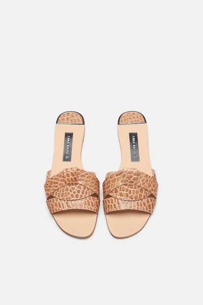 3187facad42 Image 4 of LEATHER CROSSOVER SANDALS from Zara