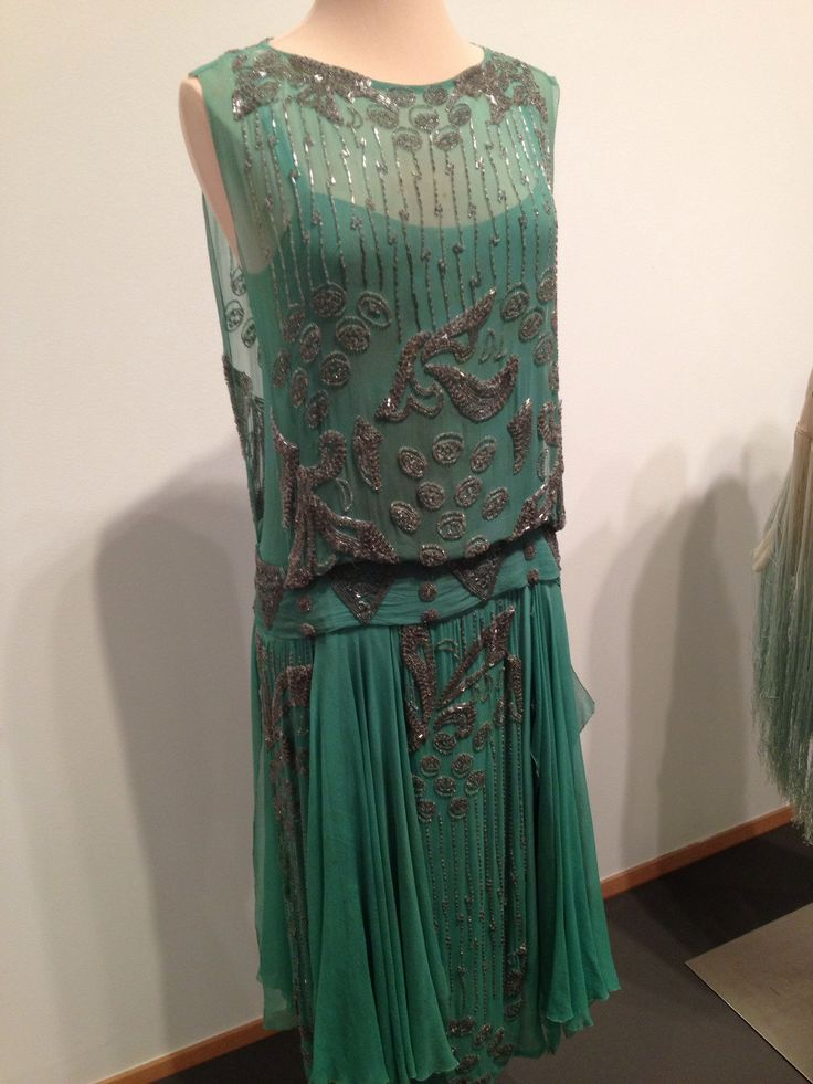 1920s evening dress from local museum exhibit. Tutankamon's tomb had only recently been discovered so clothes reflected the interest in Nile greens and often with Egyptian motifs.