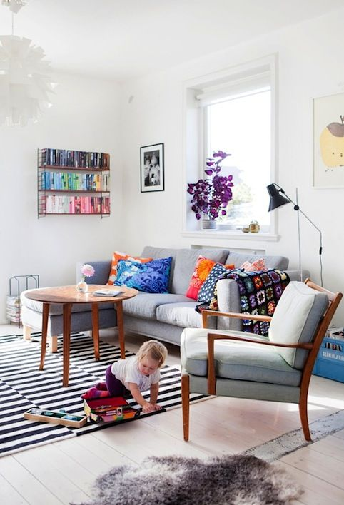 White walls, grey couch, brights.