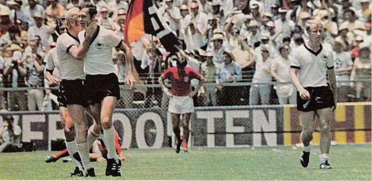 14th June 1970. West Germany's Karl-Heinz Schnellinger congratulates Franz Beckenbauer following his goal against England that reduced their lead to just one, in the World Cup.