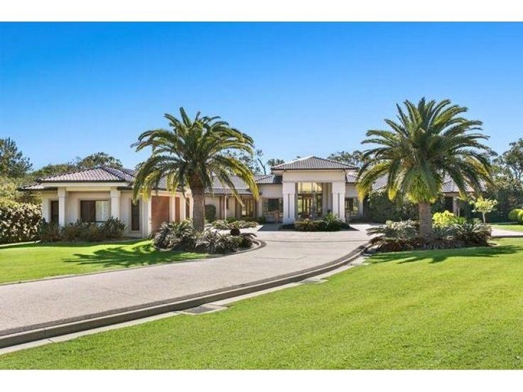 Front of house - interesting.  Lose the palm trees.  take the rest.  620 London Road, Chandler, Qld 4155