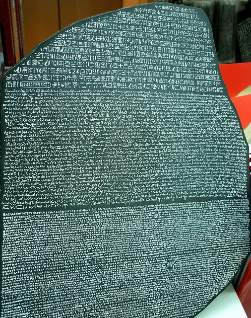 The Rosetta Stone has the same inscription written in three languages; Ancient Egyptian hieroglyphs, Demotic, and Greek. Its discovery in 1799 was key to figuring out the hieroglyphic writing system, thus allowing modern historians to unlock the contents of many manuscripts and carvings that were previously unknown. The Rosetta Stone is currently located in the British Museum.
