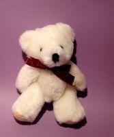 "4 1/2"" when standing.  White teddy bear.  Sold in MINIATURE ANIMALS on website http://barbspencerdolls.com"