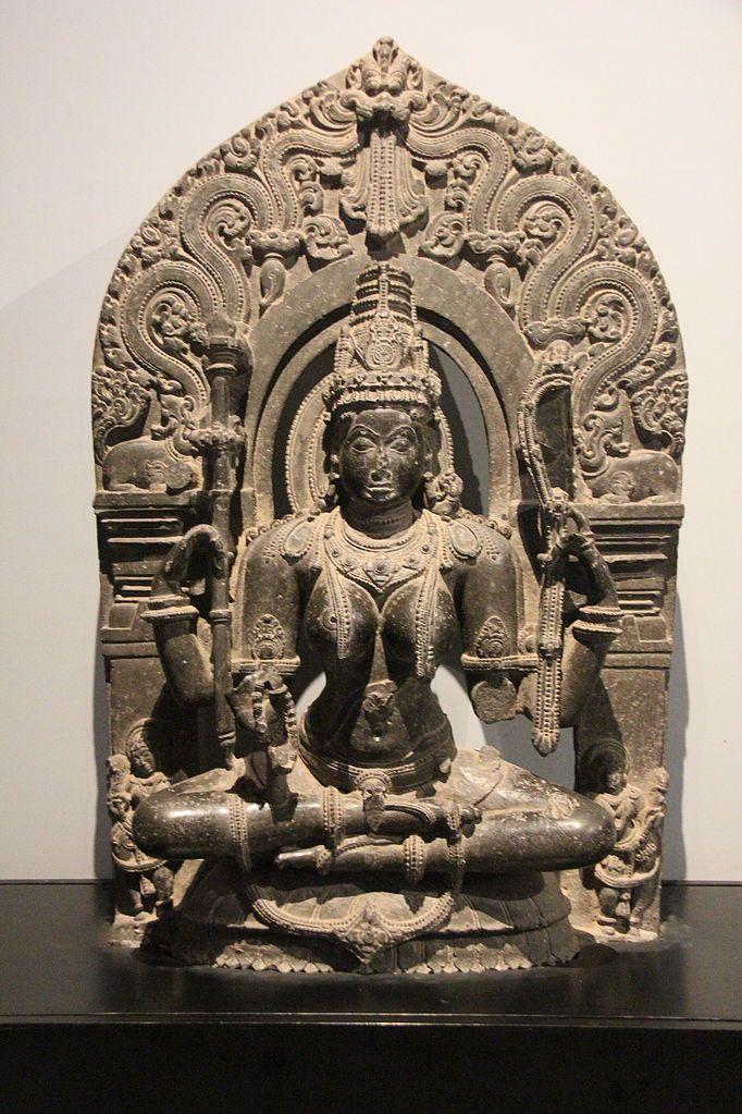 Saraswati idol (note the flute & rosary) made of black stone from late Chalukya dynasty period (12th century CE). Idol on display in Chhatrapati Shivaji Maharaj Vastu Sangrahalaya, Mumbai, India