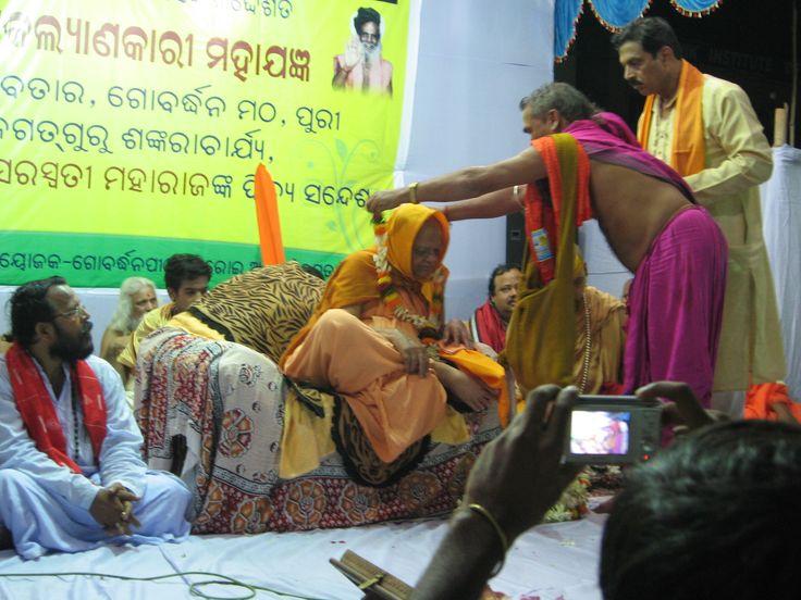Puri Shankaracharya being honored by Pundit Amareswar Mishra, after completion of the 2012 Khandagiri Yajna