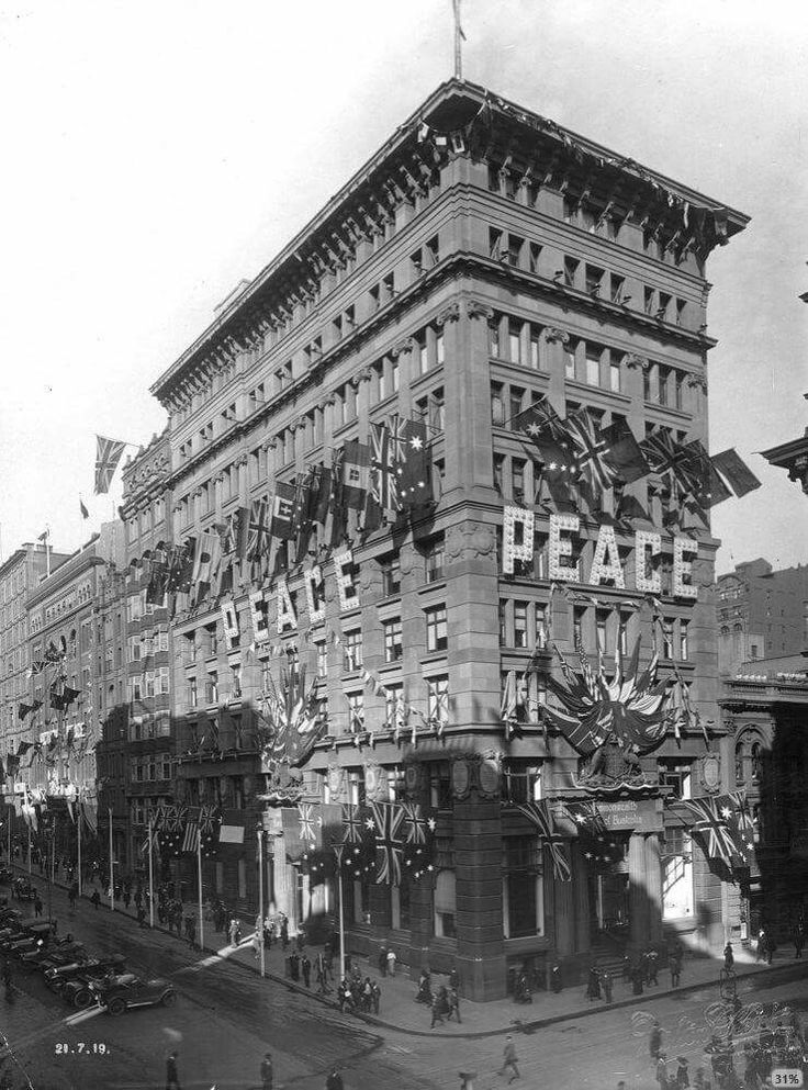 """The facade of the Commonwealth Bank of Australia's head office at the corner of Martin Place and Pitt St,Sydney.The building was decorated with the word """"Peace"""" in large letters in 1919."""