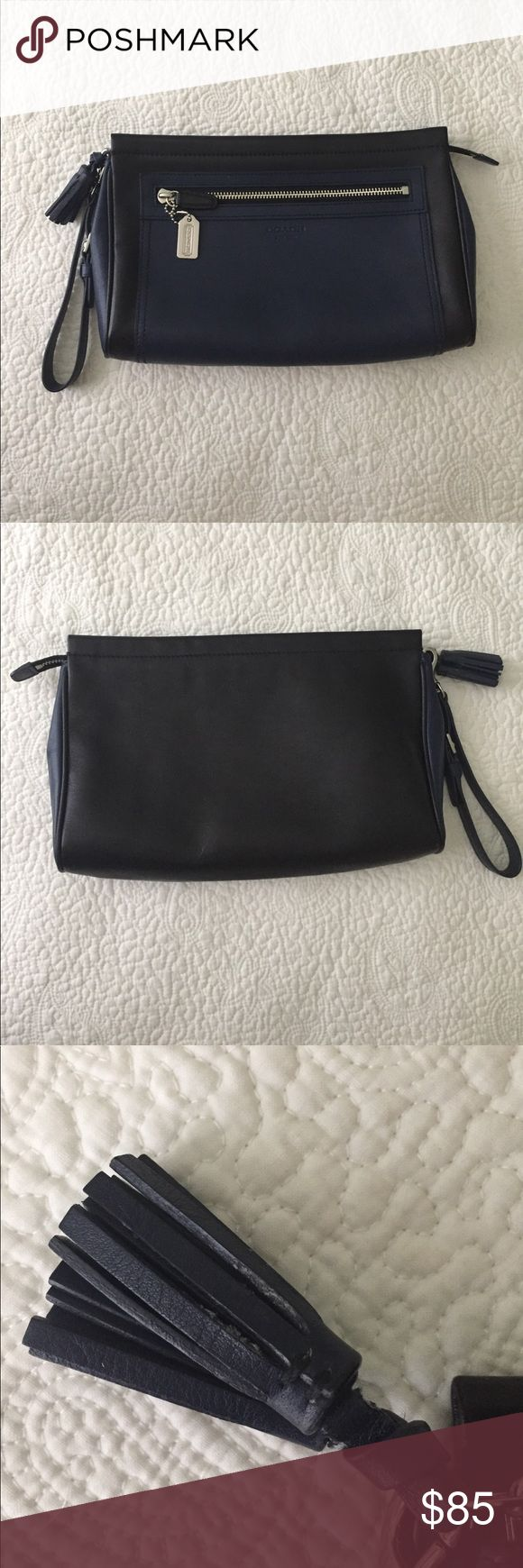 "Coach Legacy Large Colorblock Clutch Wristlet Coach Legacy large colorblock clutch.  Used, but in good condition.  Tassel and corners show a bit of wear.  Cotton lined interior has a slip pocket.  Front pocket can hold my iPhone 6.  Overall clean and nice!  Approximately 10"" long. Coach Bags Clutches & Wristlets"