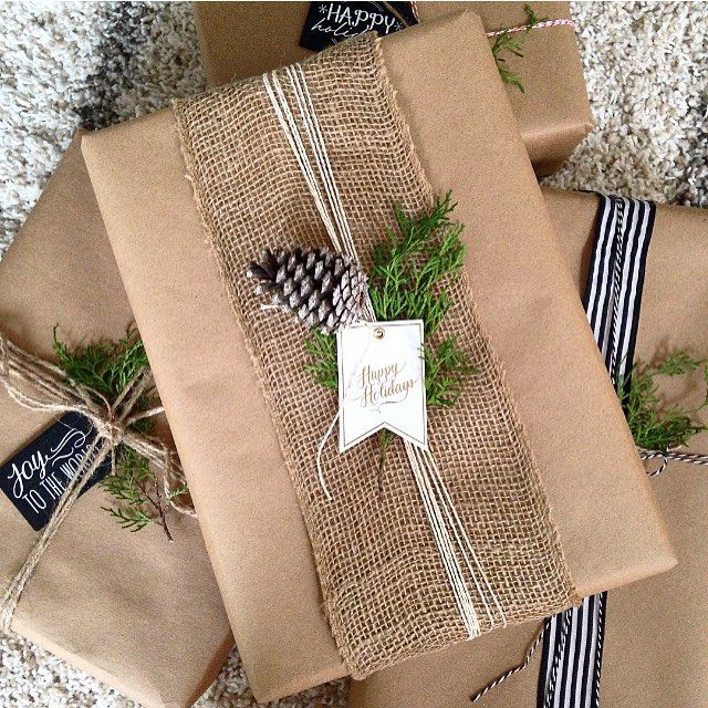 Brown paper packages tied up with string. This is my favorite way to wrap presents: kraft paper with twine, burlap, and pinecones. @theothersideofneutral #22