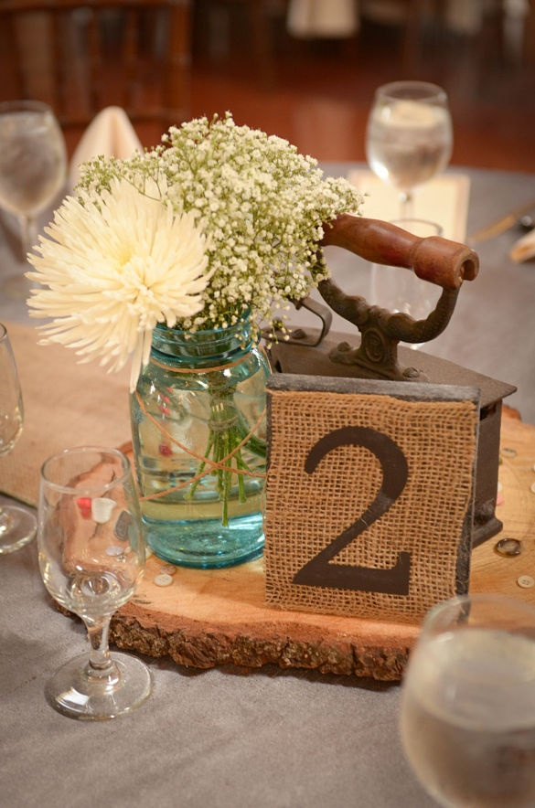 I made the table numbers using wood squares, chalkboard paint, burlaps and my Cricut!