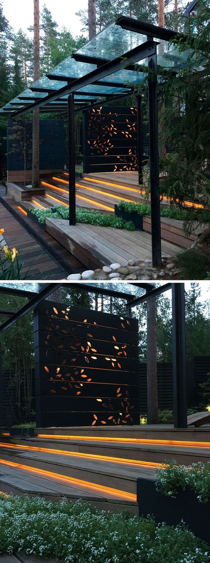 This gym has an landscaped outdoor area with hidden lighting under the steps, built-in planters, and a decorative screen that has an artistic leaf pattern that lights up.