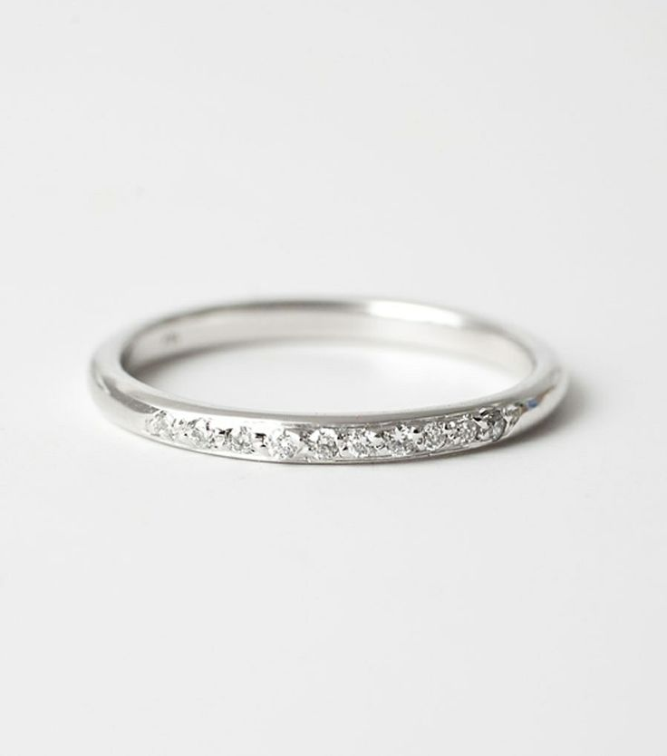 Round Band with Ten Diamonds, White Gold. Dainty band, perfect for stacking with just the right amount of sparkle. Available at www.catbirdnyc.com.