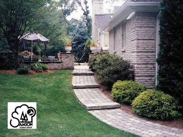 paver walkway on a slope. nice landscaping ideas too.