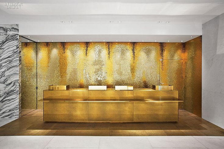 Glass Mosaic tile lines the basement alcove housing a cash-wrap desk. Guerlain, by Peter Marino Architects #luxury #interiordesign #retail