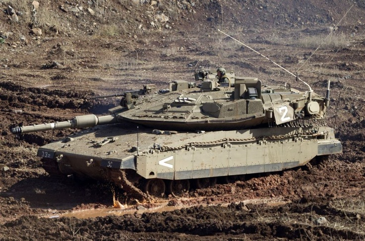 "An Israeli tank in a firing position in the Israeli-controlled Golan Heights overlooking the Syrian village of Bariqa, Monday, Nov. 12, 2012. The Israeli military says ""Syrian mobile artillery"" was hit after responding to stray mortar fire from its northern neighbor. The incident marked the second straight day that Israel has responded to fire from Syria that does not appear to be aimed at Israeli targets, nonetheless Israel has promised a tough response if the fire continues."
