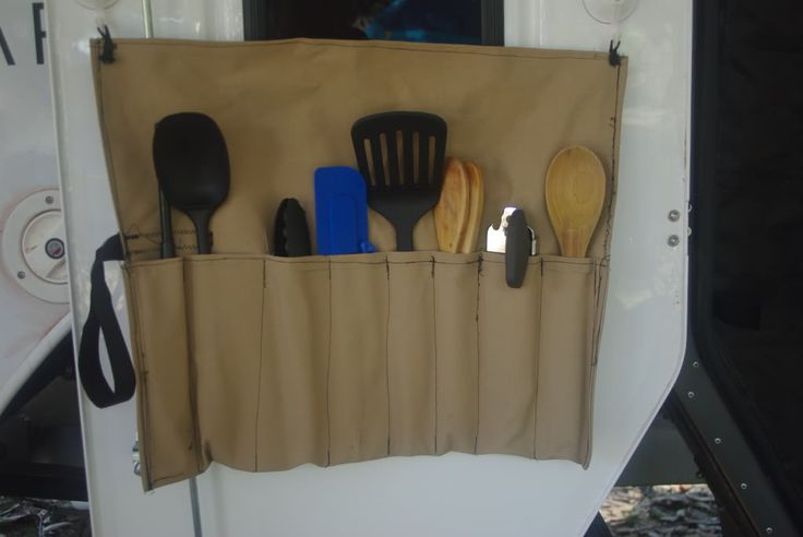 DIY camping utensil organizer. Use suction cups to hold it up. Love this!