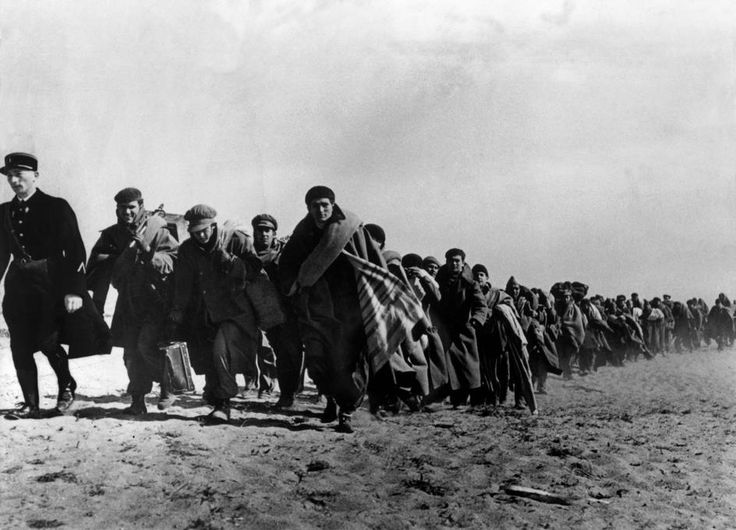 robert capa: le barcarès, france. exiled republicans being transferred from one part of a concentration camp for spanish refugees to another (march 1939).