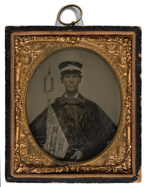 Rare Ambrotype c. 1860 of Abraham Lincoln Wide Awake marcher with cap, cape, swing torch and campaign flag.