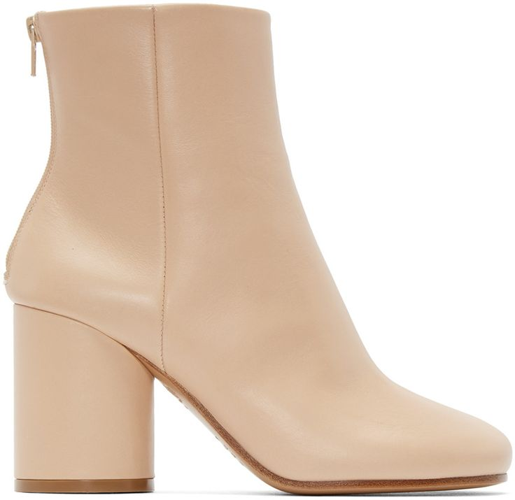 Ankle-high brushed leather boots in beige. Round toe. Zip closure at heel. Signature stitch detail in white at heel counter. Covered cylindrical block heel. Leather sole in beige. Approx. 3