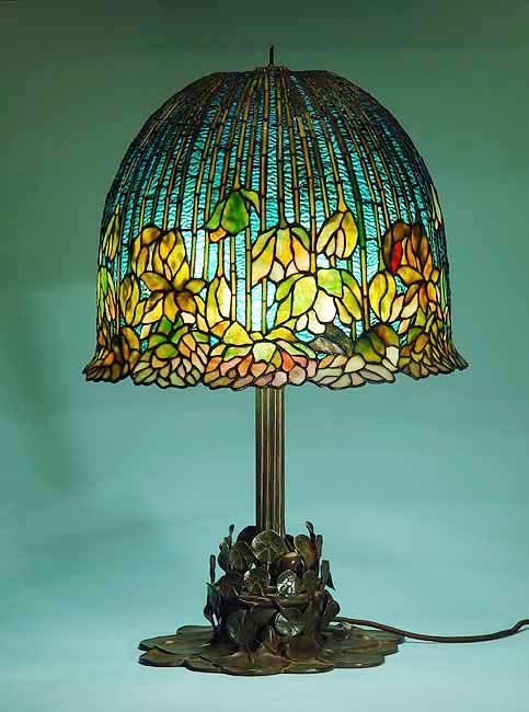 Flowering lotus tiffany lamp on bronze casted tiffany lamp base find this pin and more on tiffany lamps and stained glass