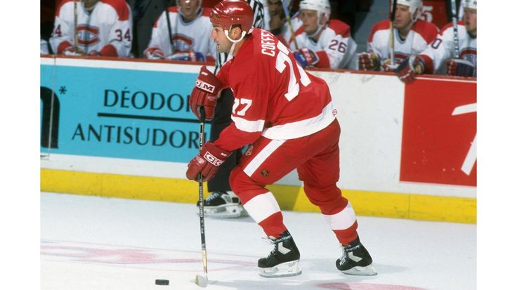 MONTREAL, QC - 1993: Paul Coffey #77 of the Detroit Red Wings skates with the puck during an NHL game against the Montreal Canadiens circa 1993 at the Montreal Forum in Montreal, Quebec, Canada. (Photo by B Bennett/Getty Images)