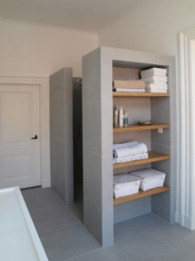 build in shelf storage like this if making a wall for showerbath. facing to door as here. maybe incorporate laundry basket into bottom shelf area or put doors on here
