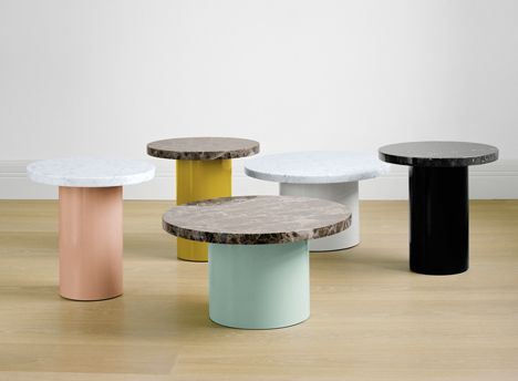 Side tables that combine marble tops with coloured steel bases