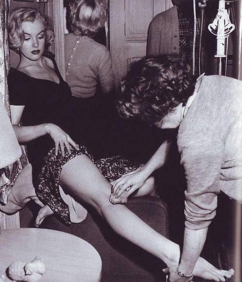 Marilyn Monroe having her legs made up, 1951