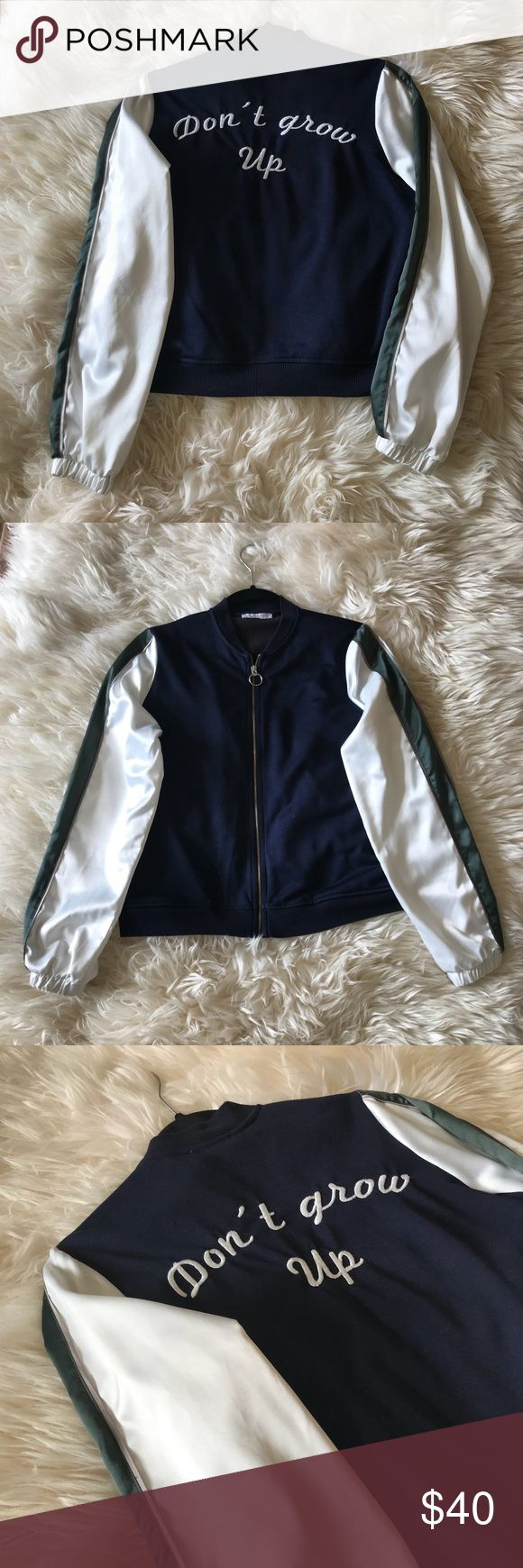 """Zara bomber jacket Zara bomber jacket with satin-like sleeves. The body is a navy blue knit material and the sleeves are white with olive stripe. Zipper with a ring and """"don't grow up"""" quote on the back. Zara Jackets & Coats"""