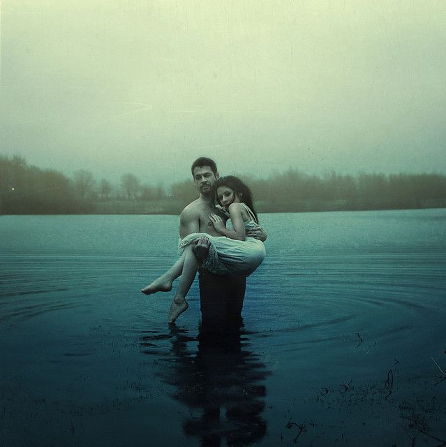 """He held her close calling her name, begging her to stay with him. Her small body trembled against his, eyes staring up at him in confusion. """"Please,"""" he whispered, his voice cracking, tears streaming down his face. The waves of the lake making him stumble slightly towards the shore."""
