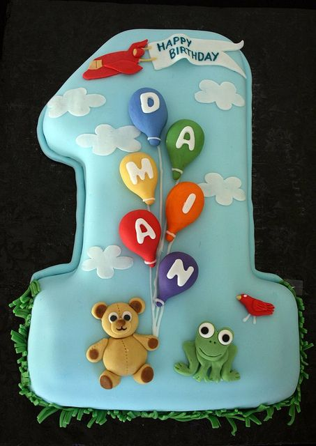 A beautiful balloon birthday cake to celebrate a first birthday. Personalised with name and favourite things; a great idea that can be adapted to any age.