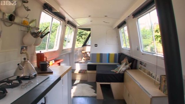 Dominique Brown's narrowboat is40 feet in length and 6 foot 2 width. With the layout being as open plan as possible. Each area within the boat having uses which can be adjusted with the flick of a hinge or the slide of slats. The L-shaped sofa  can simply slide-out into a double bed with upholstery folding to suit. Similarly, all worksurfaces on one side flip up or down for dining or preparing. There are 2 sliding doors. Between is closet space and drawers in the walk through to the…