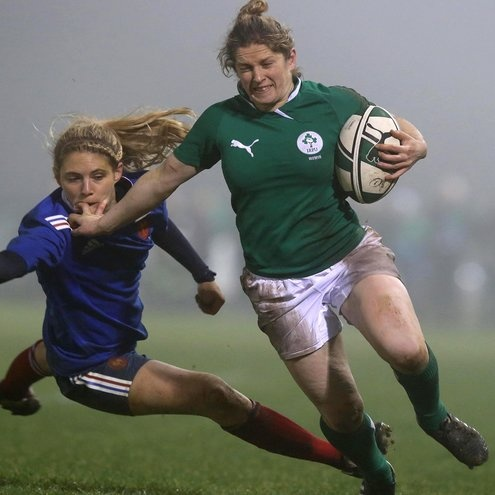 Alison Miller, the Six Nations' top try scorer with five tries, fends off France's Marjorie Mayans