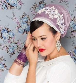 A purple tichel with white flower lace dentelle and purple, cream and light blue pearls is the perfect headscarf for an elegant event or holiday.