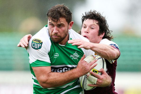 Callum Gibbins Photos Photos - Callum Gibbins of Manawatu is tackled by Tim Boys of Southland during the ITM Cup Championship Semi Final match between Manawatu and Southland at FMG Stadium on October 18, 2014 in Palmerston North, New Zealand. - Manawatu v Southland - Championship Semi Final