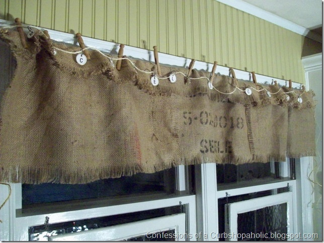 Inexpensive; but creative window treatment idea I think it would be really cute on a rod with the burlap folded over (just like it looks) but secured with buttons. When I saw this picture small, that's exactly what I thought the little letter tags were. So in my head it would look very much like this.