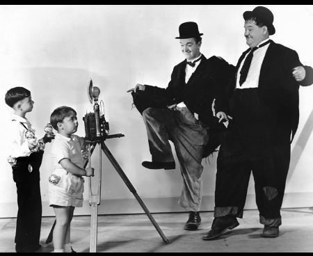 With Laurel and Hardy.